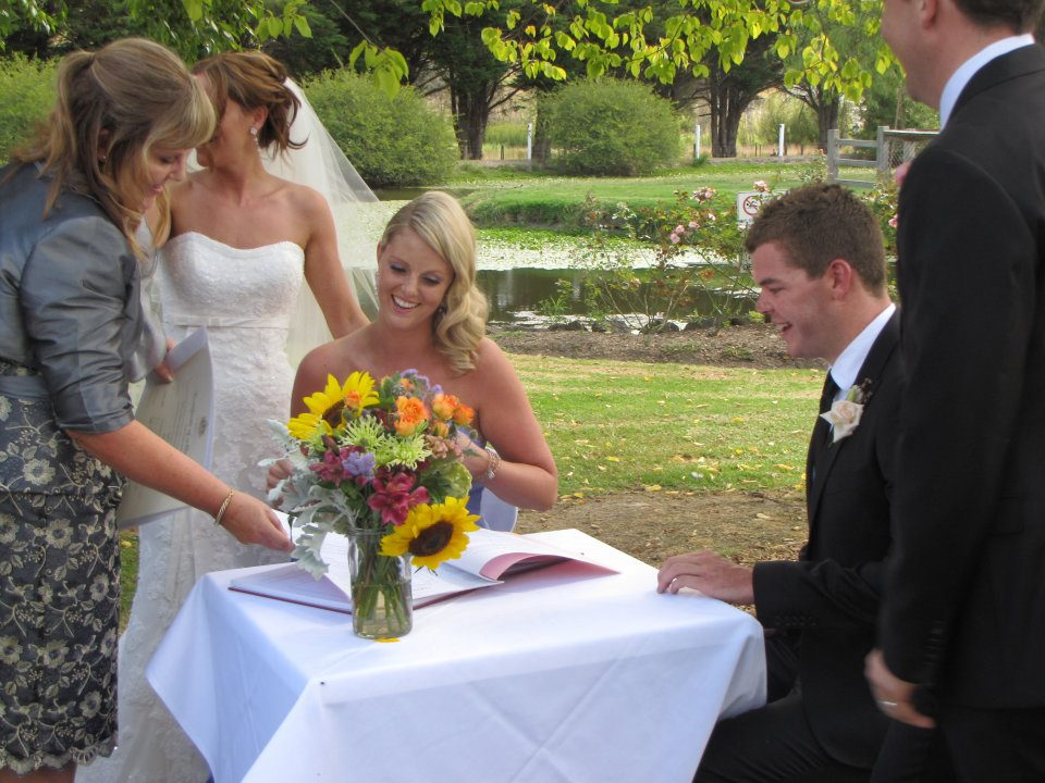 Best man & bridesmaid signing